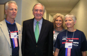 Senator Tom Harkin, of Iowa, shares a special time with Dan Fisher, Rachel Freund, and Lauren Spiro
